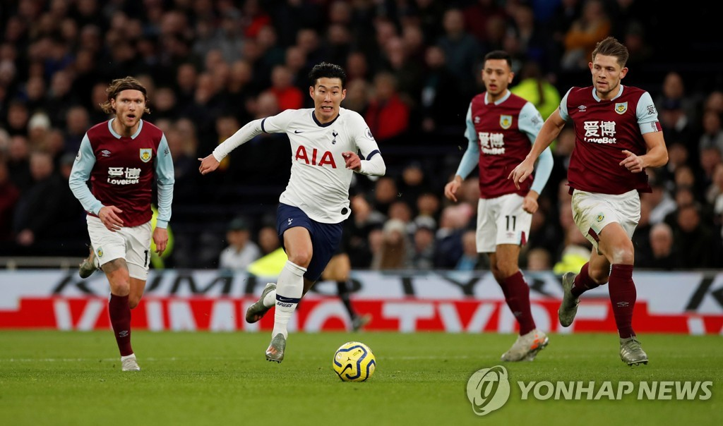 In this Reuters photo, Son Heung-min of Tottenham Hotpsur (2nd from L) dribbles through the Burnley defense during the clubs' Premier League match at Tottenham Hotspur Stadium in London on Dec. 7, 2019. (Yonhap)
