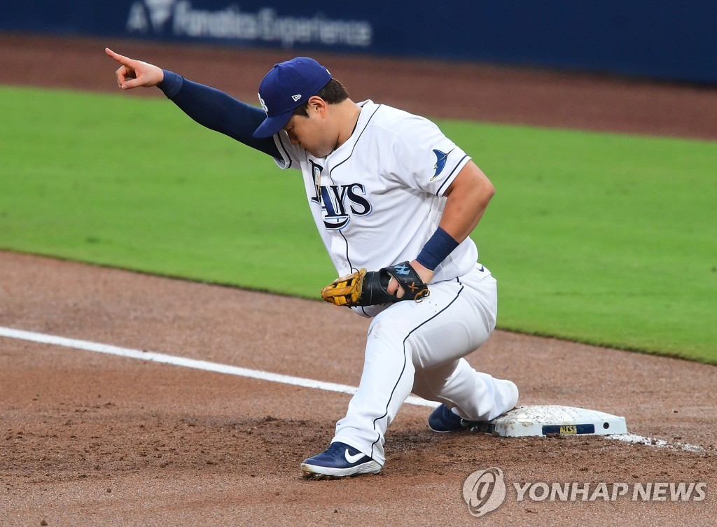 In this USA TODAY Sports photo via Reuters, Choi Ji-man of the Tampa Bay Rays points to shortstop Willy Adames after retiring Alex Bregman of the Houston Astros at first base during the top of the second inning of Game 7 of the American League Championship Series at Petco Park in San Diego on Oct. 17, 2020. (Yonhap)