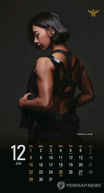 Police officers model for New Year's calendar