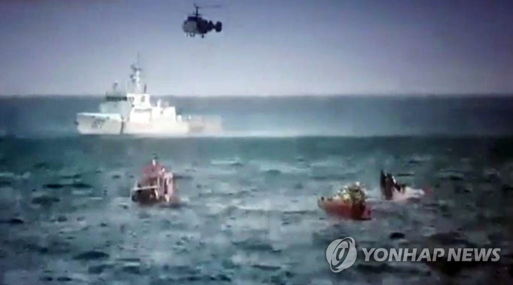 This photo, provided by the Coast Guard on Jan. 11, 2019, shows rescue operations under way for passengers aboard a leisure fishing boat that overturned off South Korea's southern coast. (Yonhap)