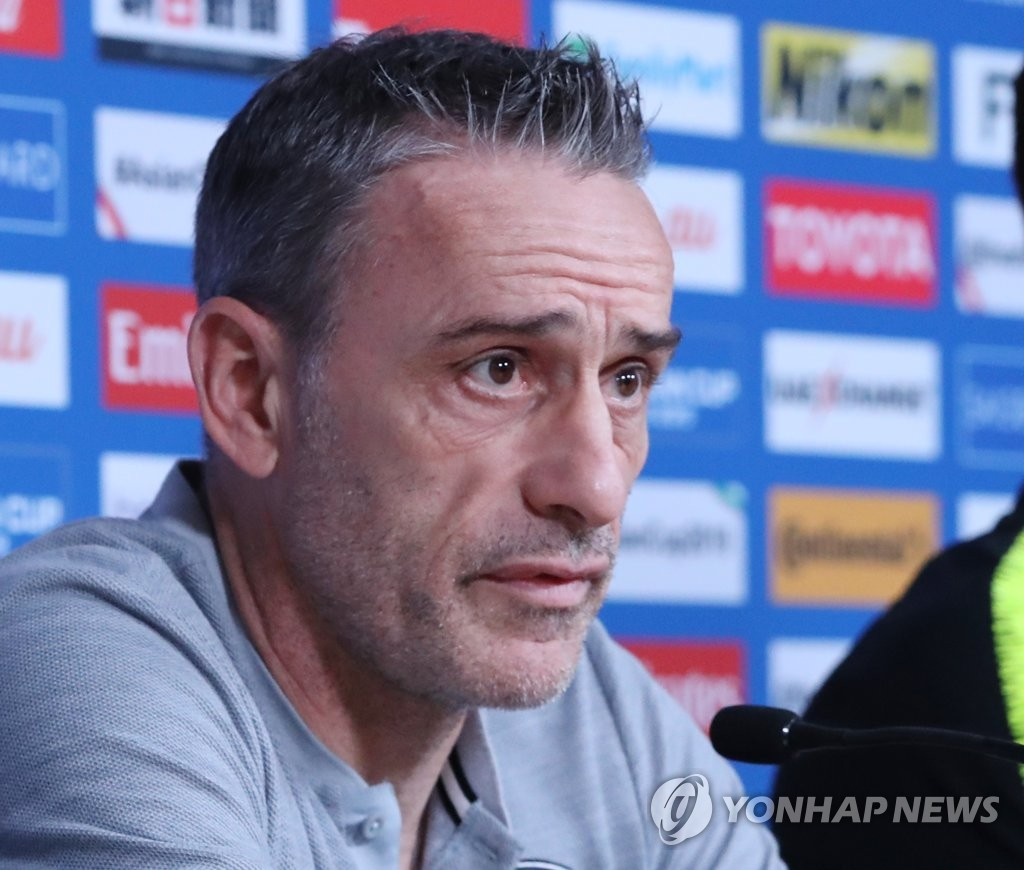 South Korea head coach Paulo Bento listens to a question during a press conference ahead of a Group C match against China at the Asian Football Confederation (AFC) Asian Cup at Al Nahyan Stadium in Abu Dhabi on Jan. 15, 2018. (Yonhap)