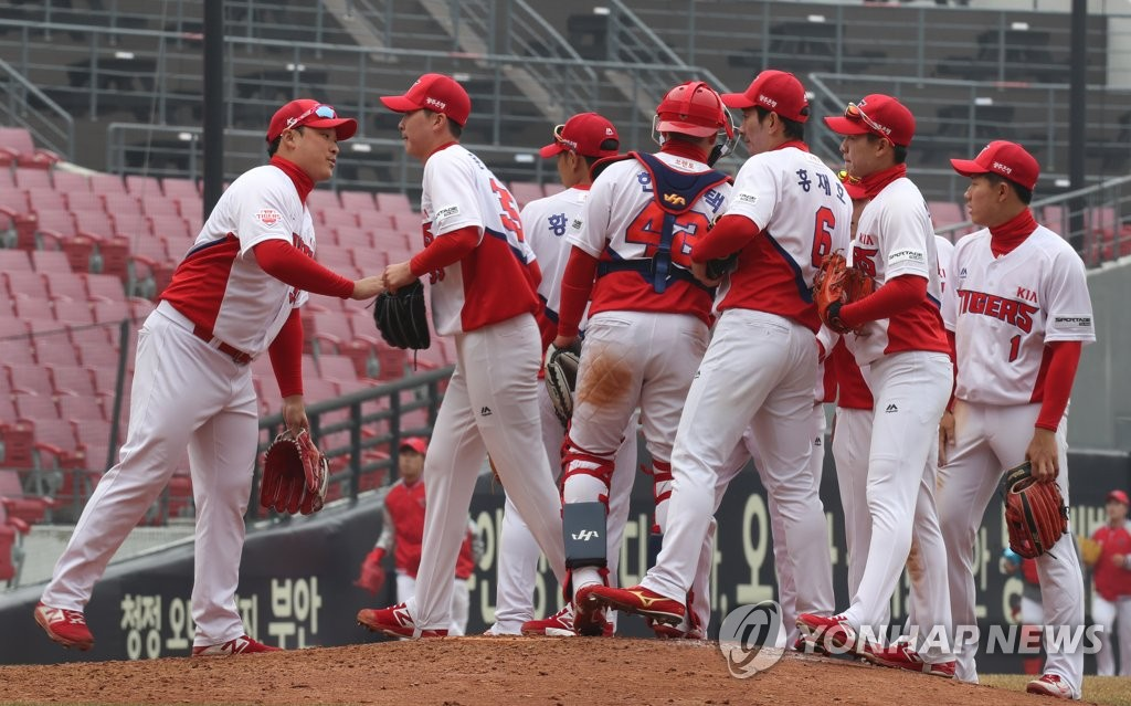 In this file photo from March 12, 2019, players of the Kia Tigers celebrate their 4-1 victory over the SK Wyverns in the Korea Baseball Organization preseason action at Gwangju-Kia Champions Field in Gwangju, 330 kilometers south of Seoul. (Yonhap)
