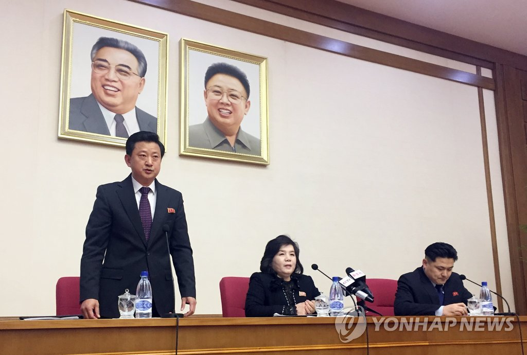 This AP photo shows North Korean Vice Foreign Minister Choe Son-hui (C) speaking to diplomats in Pyongyang on March 15, 2018, flanked by her interpreter (R) and another ministry official. (Yonhap)