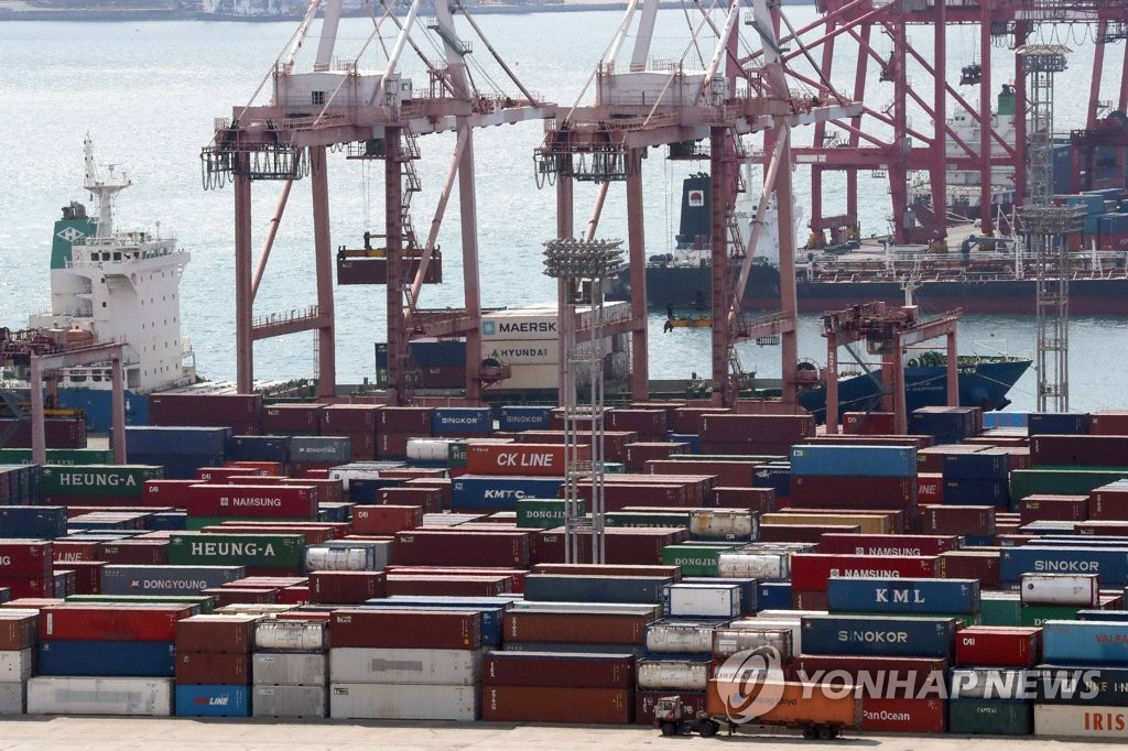 The file photo, taken on April 1, 2019, shows stacks of containers at South Korea's largest port in Busan. As of October, the country's outbound shipments dropped for 11 consecutive months, partly due to the trade dispute between its two largest importers -- the United States and China. (Yonhap)
