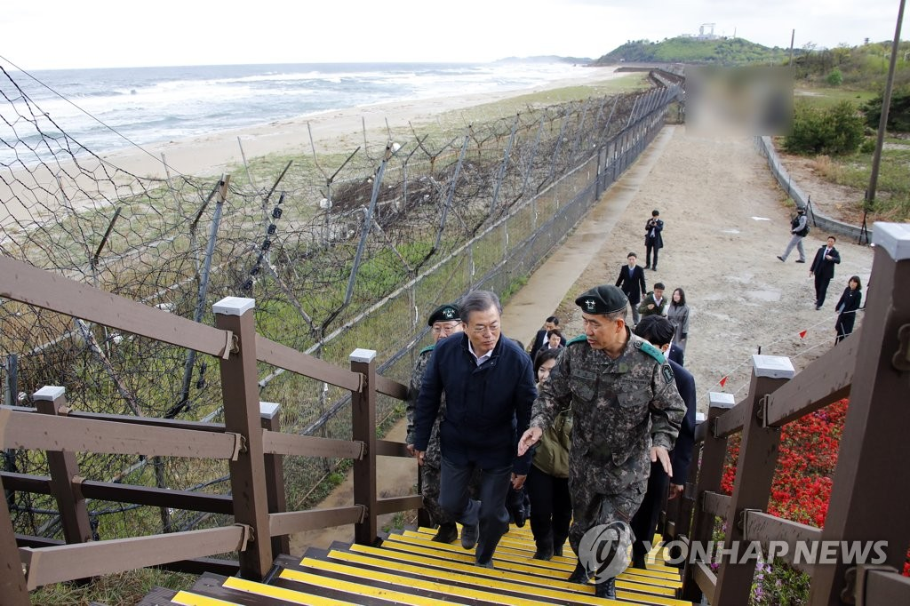 "President Moon Jae-in (L) inspects a trail adjacent to the Demilitarized Zone (DMZ), dubbed a ""DMZ Peace Trail,"" in the northeastern border town of Goseong on April 26, 2019. The trail was made public the following day. (Yonhap)"