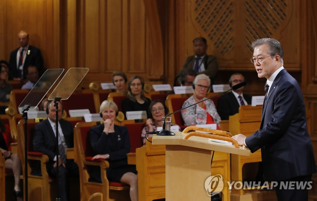 South Korean President Moon Jae-in delivers a speech on the Korean Peninsula peace process at Swedish Parliament House in Stockholm on June 14, 2019. (Yonhap)