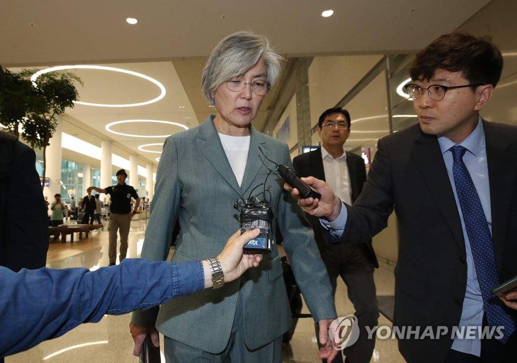 Foreign Minister Kang Kyung-wha answers reporters' questions at Incheon International Airport, west of Seoul, on June 18, 2019, after she returned from Russia, where she met with her counterpart, Sergey Lavrov, for talks on key bilateral issues, including North Korea's denuclearization. (Yonhap)