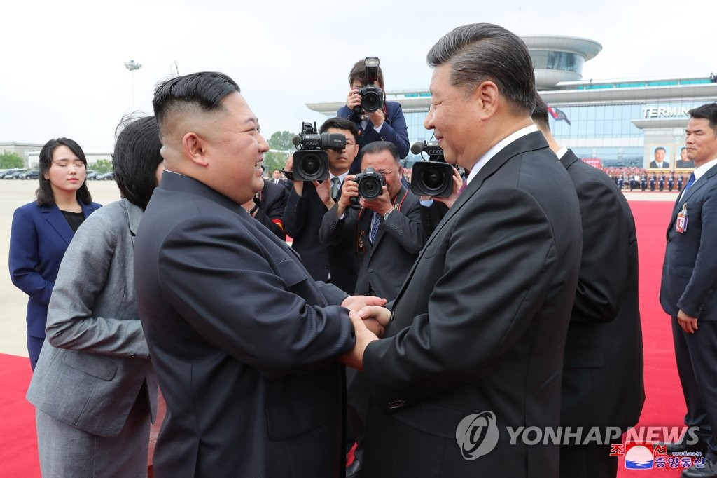In the photo, released by North Korea's official Korean Central News Agency on June 22, 2019, North Korean leader Kim Jong-un (L) and Chinese President Xi Jinping are seen shaking hands before Xi's departure from Pyongyang the previous day that concluded his two-day trip to the North Korean capital, becoming the first Chinese head of state to do so in 14 years. (For Use Only in the Republic of Korea. No Redistribution. (Yonhap)