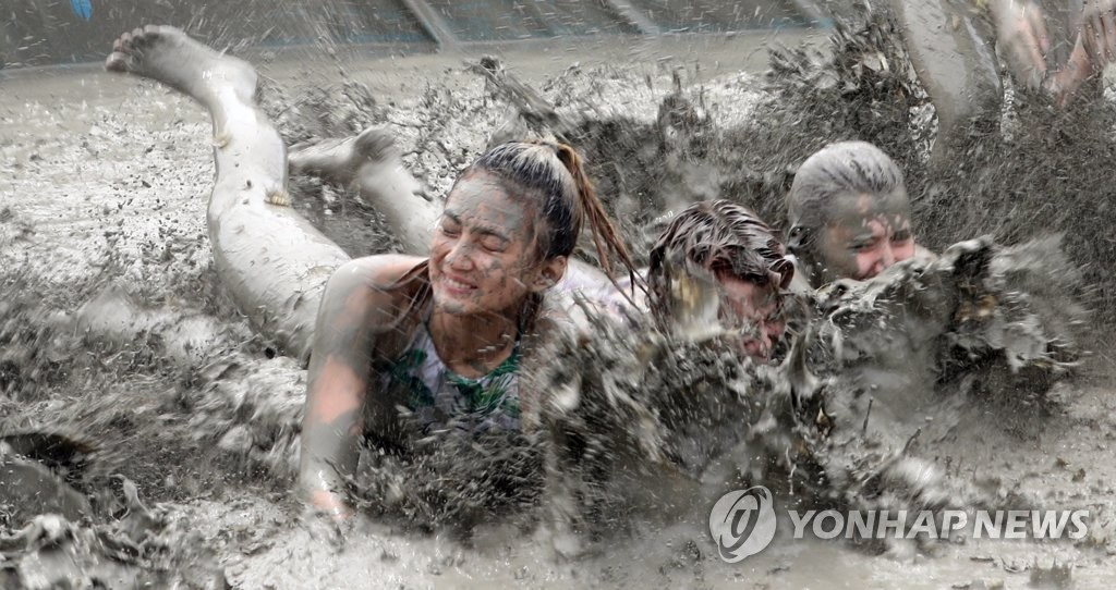 This photo, taken on July 19, 2019, shows visitors enjoying mud activities at Boryeong, 190 kilometers south of Seoul, during last year's annual mud festival. (Yonhap)