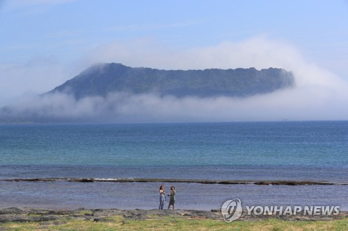 Fog-covered peak on Jeju