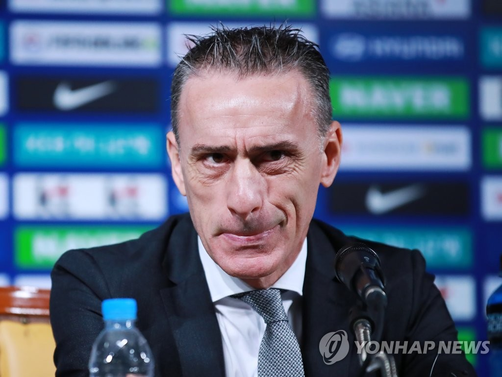 Paulo Bento, head coach of the South Korean men's national football team, listens to a question during a press conference at Korea Football Association House in Seoul on Aug. 26, 2019. (Yonhap)