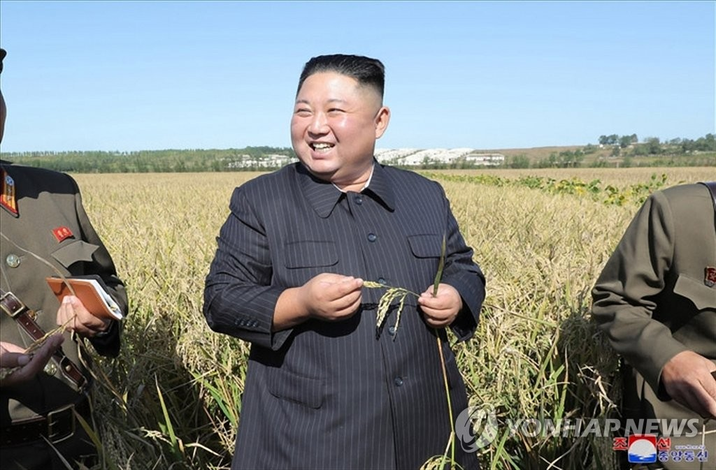 North Korean leader Kim Jong-un smiles during a visit to a military farm in this photo released by the Korean Central News Agency on Oct. 9, 2019. The visit marked Kim's first public appearance since the breakdown of working-level nuclear talks with the United States in Sweden on Oct. 5. (For Use Only in the Republic of Korea. No Redistribution) (Yonhap)
