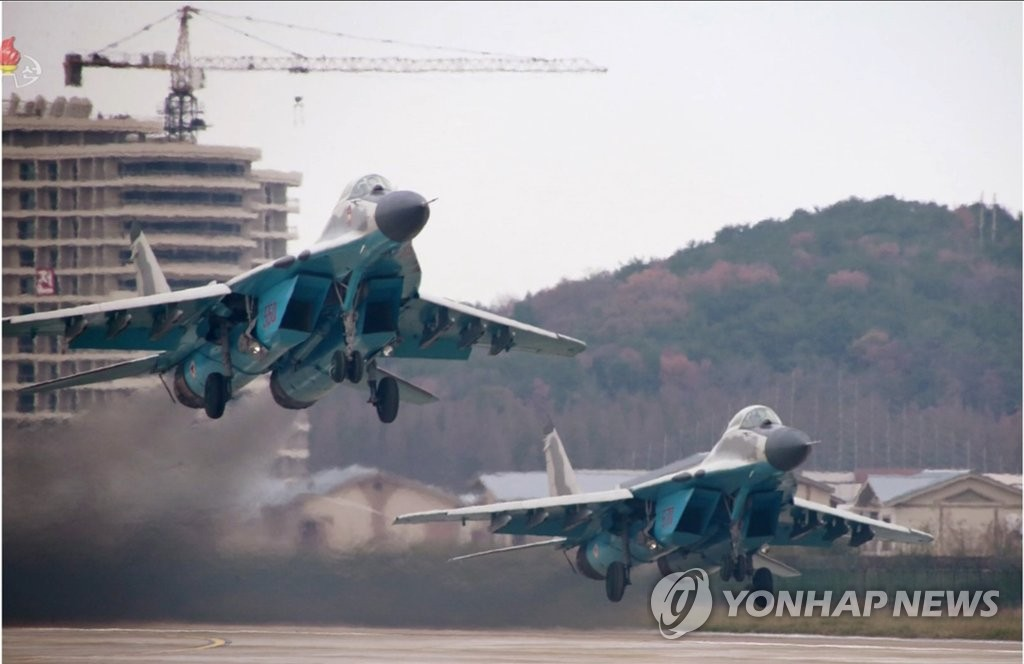 This image, captured from the North's state TV on Nov. 16, 2019, shows MiG-29 fighters at an air show at Wonsan Kalma Airport. (For Use Only in the Republic of Korea. No Redistribution) (Yonhap)