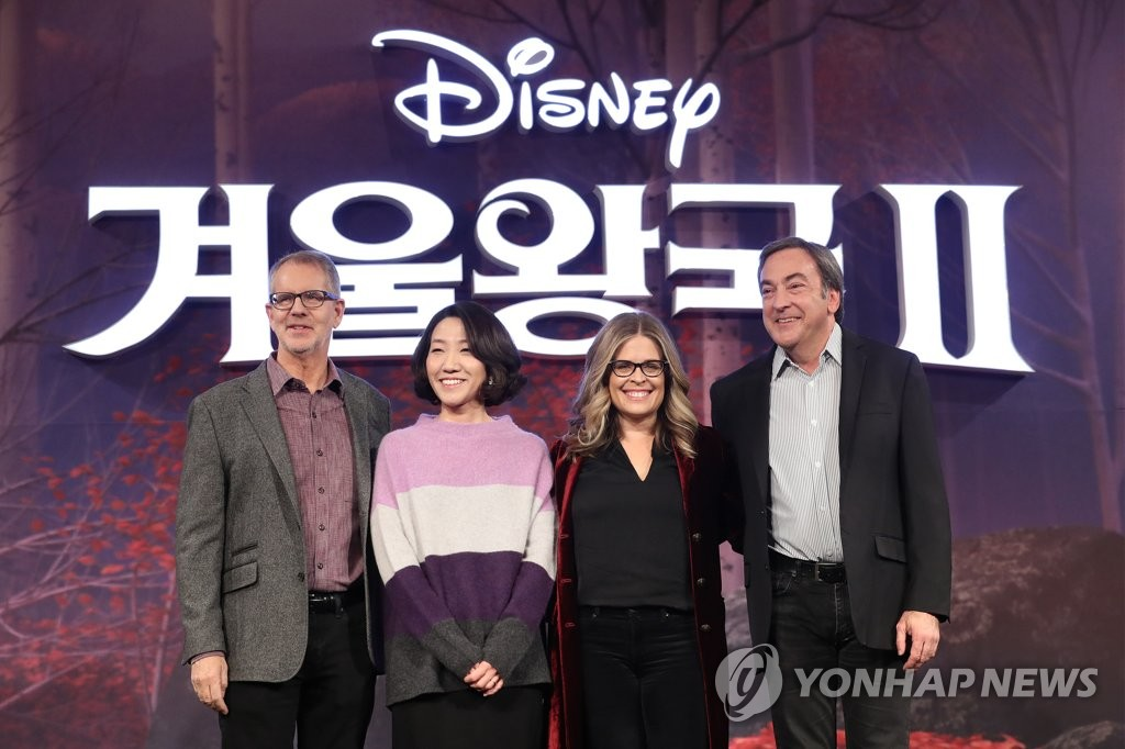 South Korean animator Lee Hyun-min (2nd from L) poses for photos at a press conference in Seoul on Nov. 25, 2019. (Yonhap)