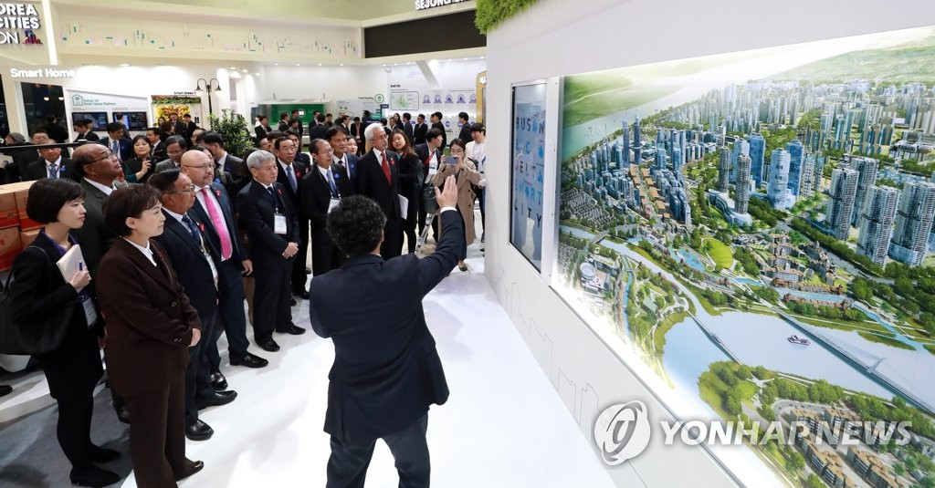 In this photo taken on Nov. 25, 2019, Transport Minister Kim Hyun-mee (2nd from left) and officials from 10 ASEAN member countries listen to a briefing on the Busan Eco Delta City, a smart city to be built by the South Korean government in the southern port city of Busan by 2024, at BEXCO exhibition hall in Busan. (Yonhap)