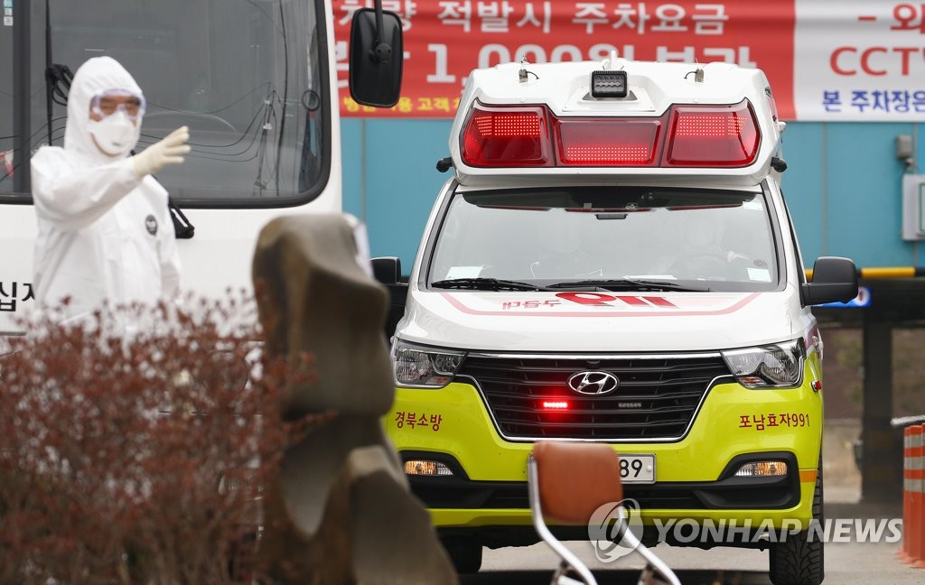This photo taken on March 1, 2020, shows an ambulance carrying a novel coronavirus patient in Daegu. (Yonhap)