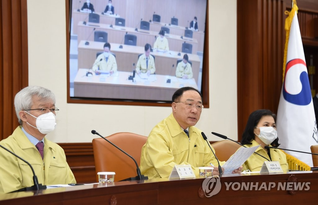 In the photo provided by the finance ministry, Finance Minister Hong Nam-ki (C) speaks in an economy-related ministers' meeting in Sejong, 110 kilometers south of Seoul, on March 6, 2020. (PHOTO NOT FOR SALE) (Yonhap)