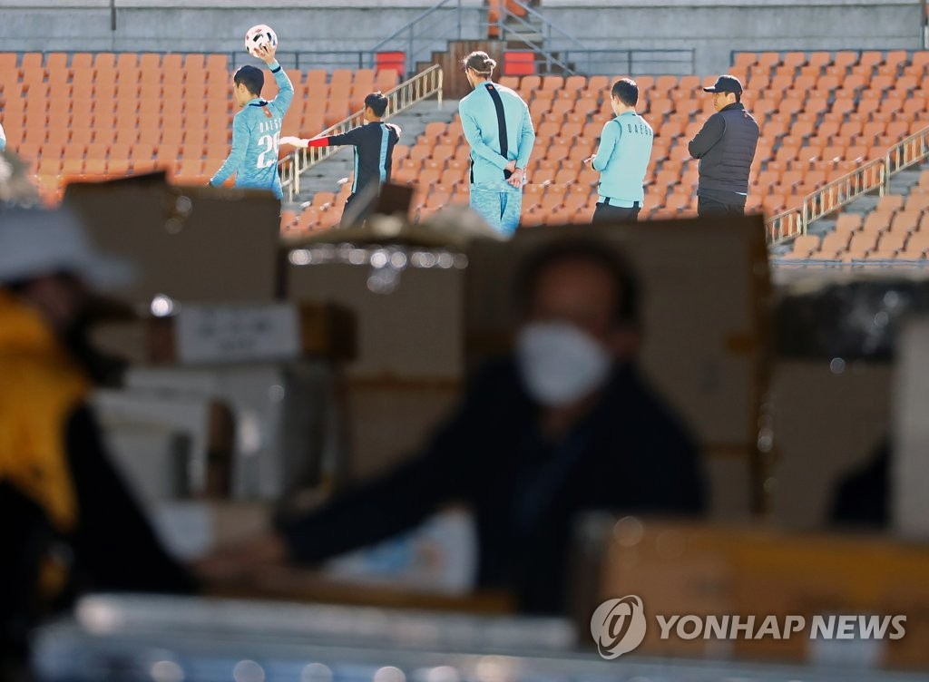 In this file photo from March 11, 2020, Daegu FC players train at Daegu Stadium in Daegu, 300 kilometers southeast of Seoul. (Yonhap)