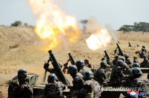 N.K. leader inspects mortar firing drill