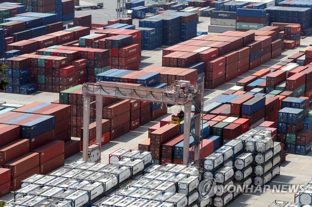 This file photo, taken on May 1, 2020, shows stacks of import-export cargo containers at South Korea's largest seaport in Busan, 450 kilometers south of Seoul. (Yonhap)