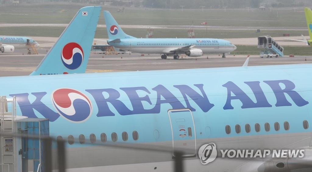 Planes of South Korea's top carrier Korean Air Lines Co. are parked at Gimpo International Airport in western Seoul on May 26, 2020. (Yonhap)
