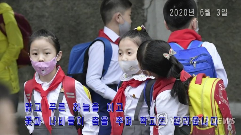 This footage, captured from Uriminzokkri Television aired in North Korea, shows North Korean students at an elementary school in Pyongyang returning to their classrooms during the coronavirus pandemic. (PHOTO NOT FOR SALE) (Yonhap)