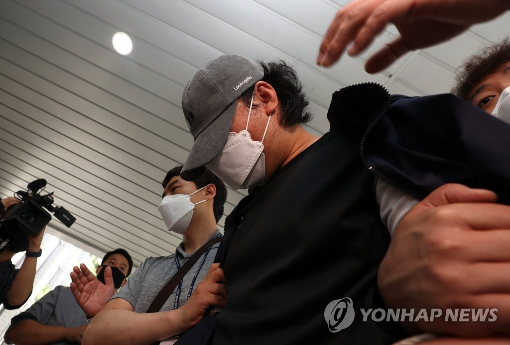 A man attends a hearing at the Miryang branch of the Changwon District Court in Miryang, 386 kilometers south of Seoul, on June 15, 2020, on allegations of abusing his step daughter. (Yonhap)