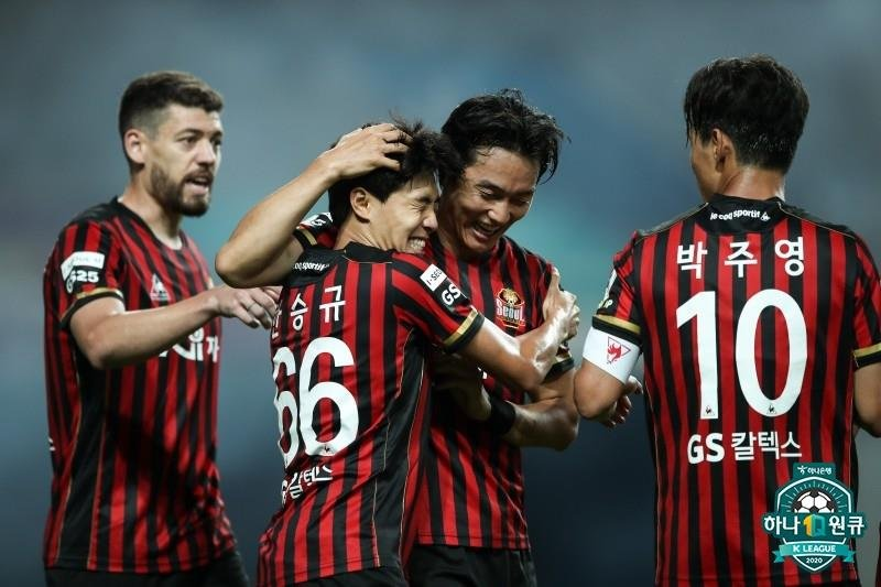 Yun Ju-tae of FC Seoul (2nd from R) embraces Han Seung-gyu in celebration of his goal against Incheon United during the clubs' K League 1 match at Seoul World Cup Stadium in Seoul on June 27, 2020, in this photo provided by the Korea Professional Football League. (PHOTO NOT FOR SALE) (Yonhap)