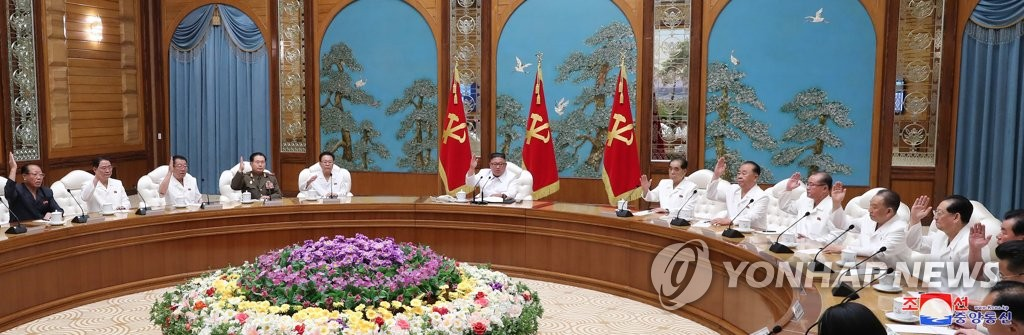 "This photo, released by the Korean Central News Agency (KCNA) on July 26, 2020, shows an emergency politburo meeting of the Workers' Party under way over the new coronavirus. At center is North Korean leader Kim Jong-un. The KCNA said Kim adopted a decision to shift to a ""maximum emergency system"" against the coronavirus in the meeting. (For Use Only in the Republic of Korea. No Redistribution) (Yonhap)"