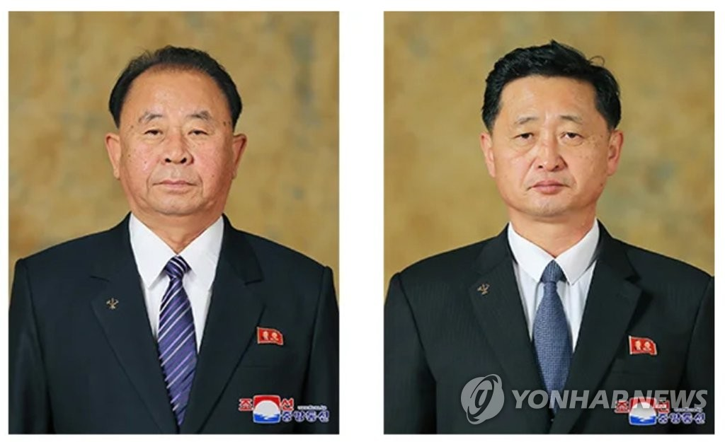 This file photo shows Kim Tok-hun (R) and Ri Pyong-chol, who were elected as members of the Presidium of the Political Bureau of North Korea's Workers' Party's Central Committee at a politburo meeting in Pyongyang on Aug. 13, 2020. (For Use Only in the Republic of Korea. No Redistribution) (Yonhap)