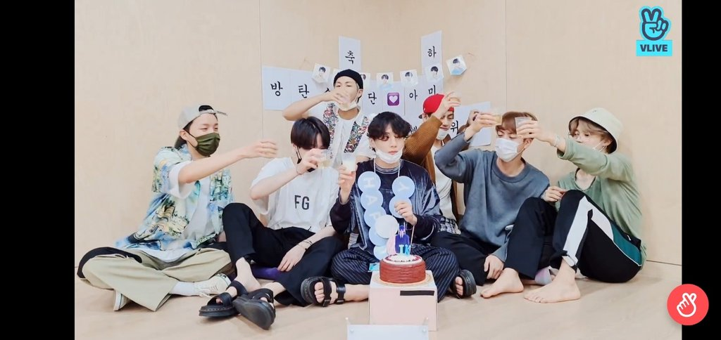 In this image captured from Naver's V Live site, members of K-pop band BTS hold an online meeting with fans on Sept. 1, 2020, in celebration of the group's ascent to the top of the Billboard Hot 100 singles charts in the United States the previous day. (PHOTO NOT FOR SALE) (Yonhap)