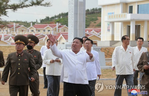 N.K. leader inspects area rebuilt from typhoon damage