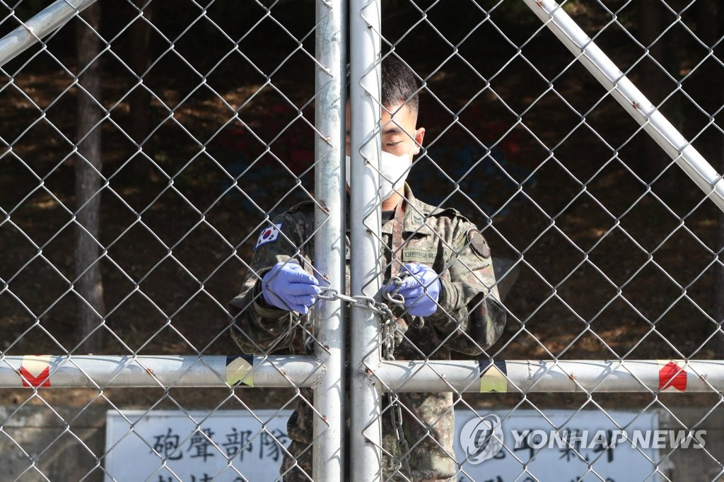 A soldier locks the gate of a military base in Pocheon, north of Seoul, on Oct. 5, 2020. (Yonhap)