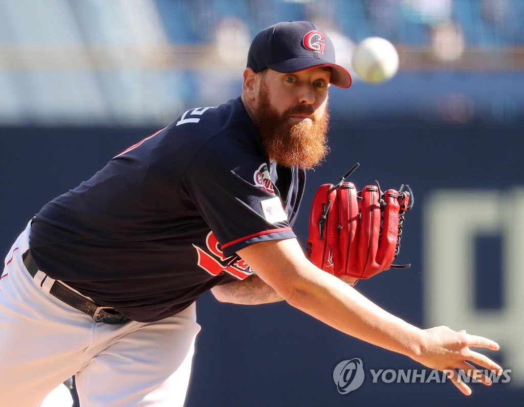 In this file photo from Oct. 18, 2020, Dan Straily of the Lotte Giants pitches against the NC Dinos during the bottom of the first inning of a Korea Baseball Organization regular season game at Changwon NC Park in Changwon, 400 kilometers southeast of Seoul. (Yonhap)