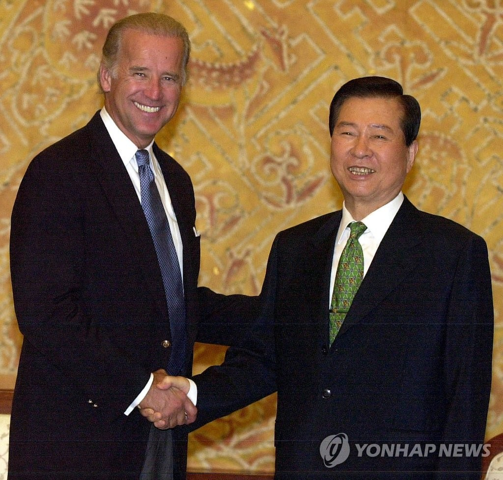 This Yonhap file photo shows now U.S. President-elect Joe Biden (L) meeting with then South Korean President Kim Dae-jung at Cheong Wa Dae in Seoul in August 2001. (Yonhap)