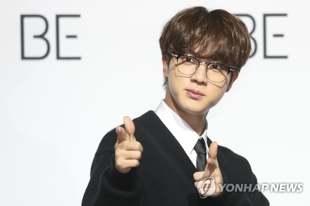 Jin of BTS poses for the camera during a press conference held at the Dongdaemun Design Plaza in central Seoul on Nov. 20, 2020. (Yonhap)