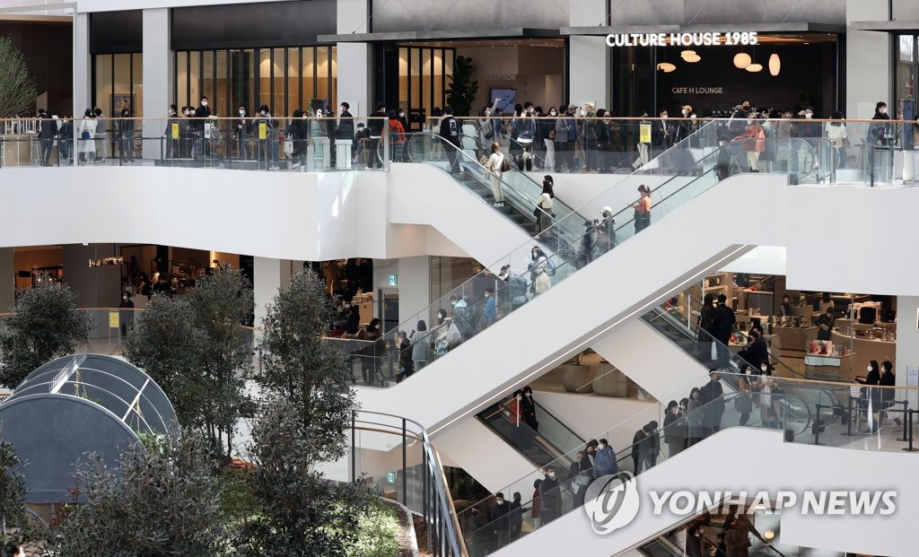This photo, taken on Feb. 26, 2021, shows people looking around The Hyundai Seoul, a newly opened department store in western Seoul. (Yonhap)