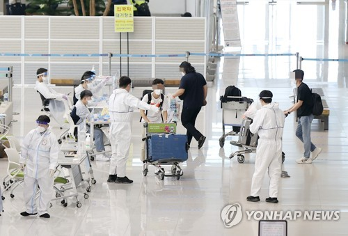 Quarantine officials at Incheon airport